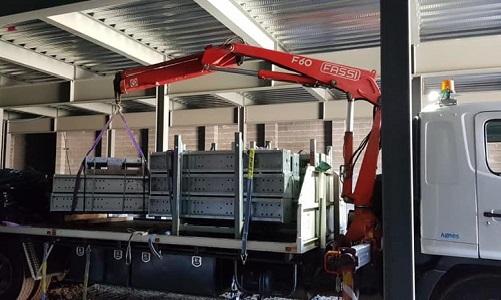 Crane truck unloading shoring equipment